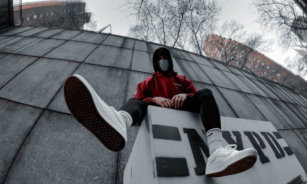Masked boy with sneakers