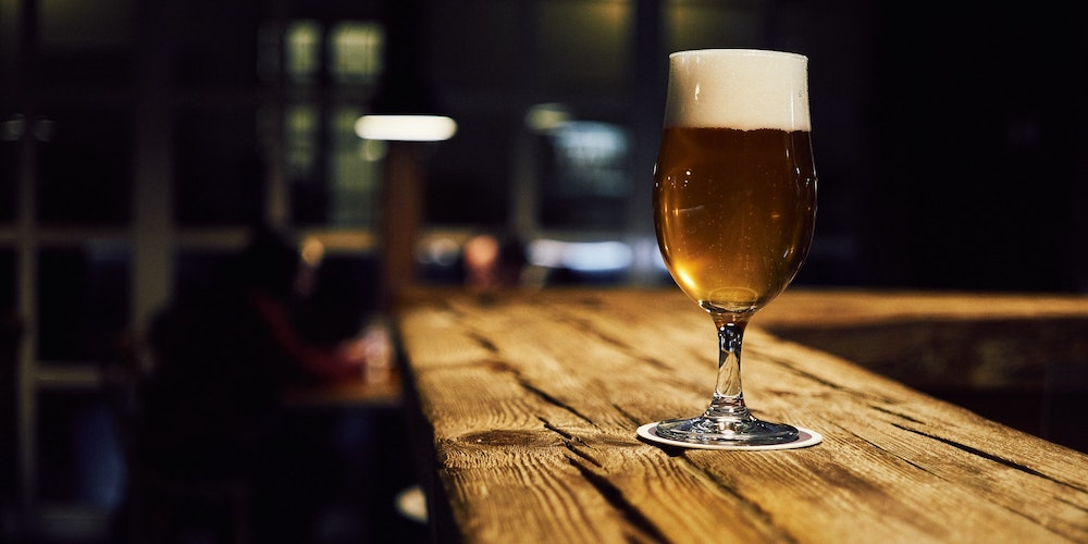 One beer alone on a bar